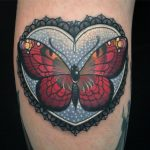 Butterfly in lacey heart frame done at Birmingham tattoo studio