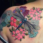 Dragonfly and flowers tattoo by Charlotte Eleanor at Modern Body Art