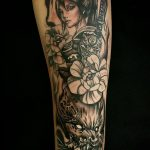 black and grey japanese tattoo of a geisha and flowers