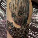 groot tattoo in black and grey