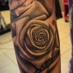 black and grey realism rose tattoo
