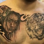 japanese black and grey chest tattoo of a tiger and geisha