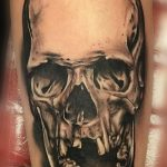 black and grey realism tattoo of a skull