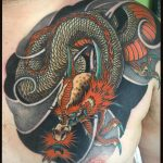 Dragon chest panel tattoo by Ricardo Pedro