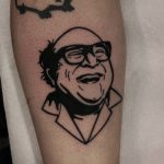 traditional blackwork danny devito portrait tattoo by Ethan Jones