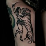 traditional blackwork circus tattoo by Ethan Jones