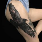 large realistic black and grey crow tattoo by Ethan Jones Modern Body Art