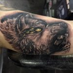 evil eyed wolf tattoo by greg Bishop