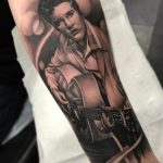 Elivis portrait tattoo
