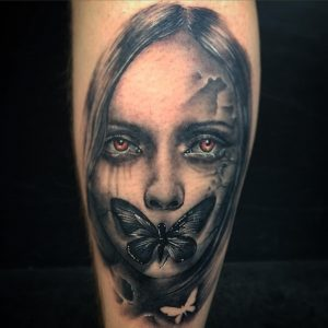 Black and grey lady face tattoo by Greg Bishop at Modern Body Art