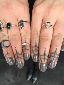 Fran's fingers have been tattooed twice
