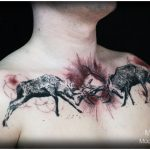 fighting stags chestpiece tattoo by Matt Hunt