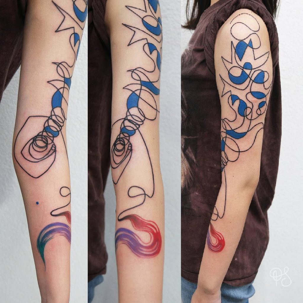 abstract face and watercolour tattoo by Paulina Szoloch