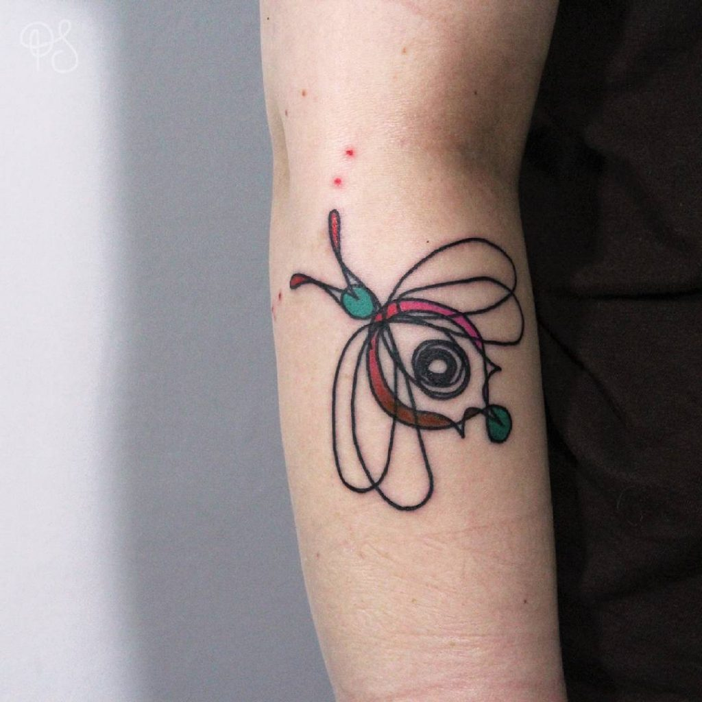 abstract eye and butterfly tattoo