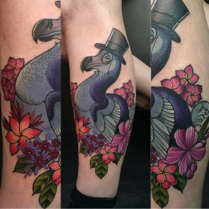 Fancy Dodo Bird tattoo with floral additions, top hat and monacle by Charlotte Timmons.